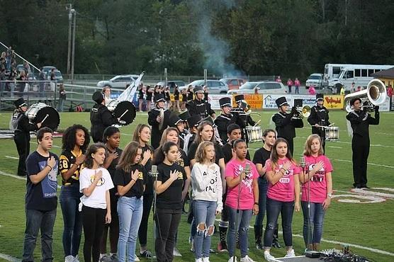 Band and Chorus Singing and Playing National Anthem at Football Game