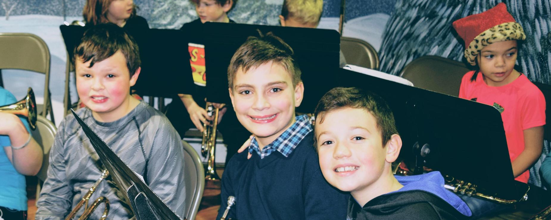 Four Cumberland Head students smile during their Band class