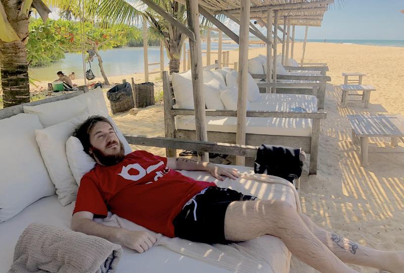 An Edlio employee relaxing on a beach lounge chair.