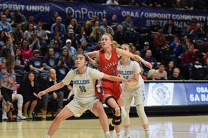 Lindsay D. fights through defenders for a rebound