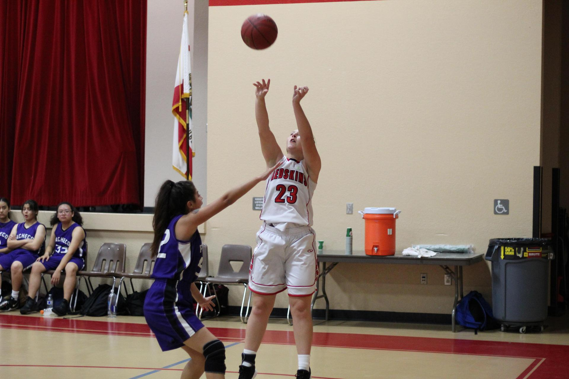 Junior Varsity girls playing basketball against Pacheco