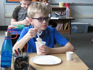A Lee third-grader enjoys a Vernor's and Hudsonville Ice Cream float.