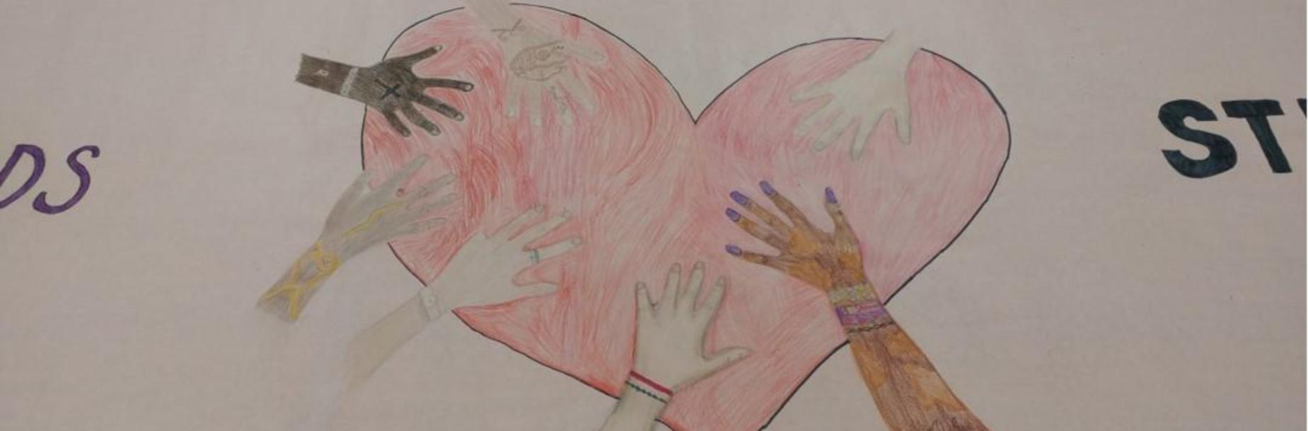 Student artwork heart with hands