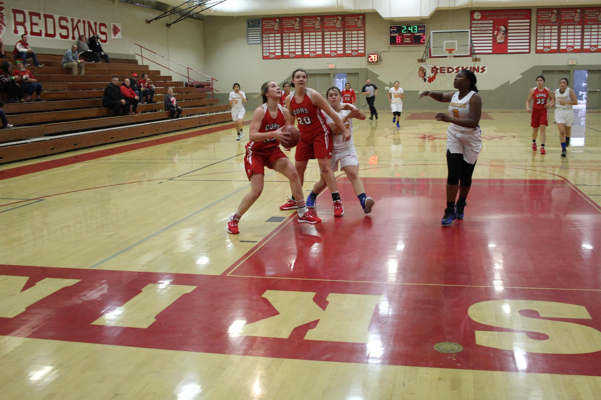 girls playing basketball against Dos Palos