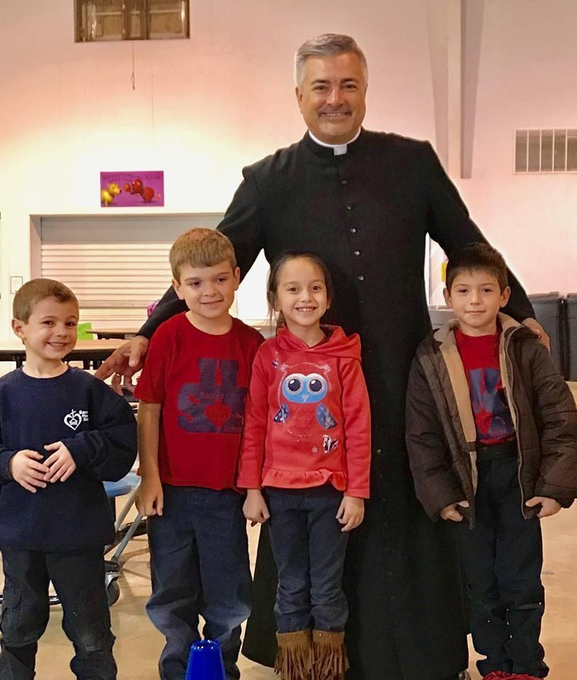 Father Ray with kids