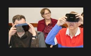 Two men enjoying a virtual reality tour