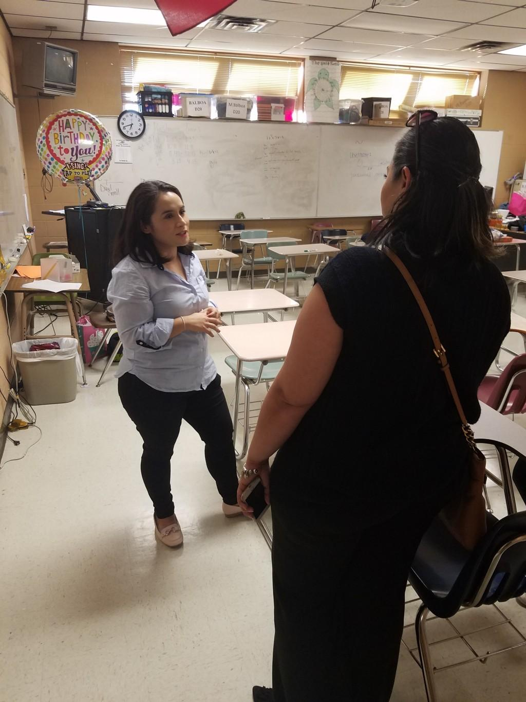 Ms. Balboa speaking with a parent during Meet The Teacher Night.