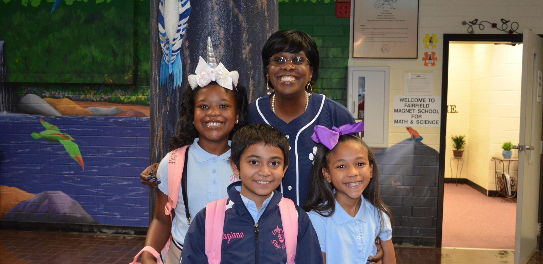 Principal Whitfield with her students
