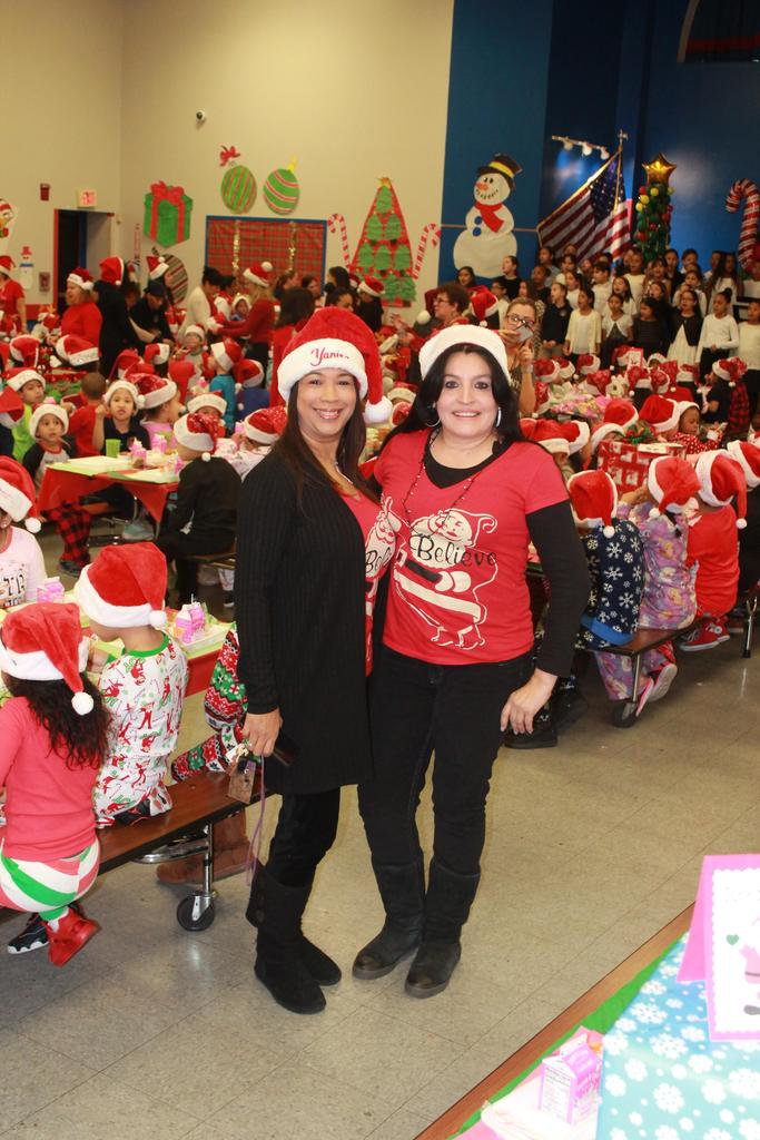 two female aides santa helpers