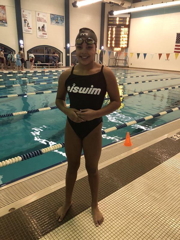 Student breaks school swim record.