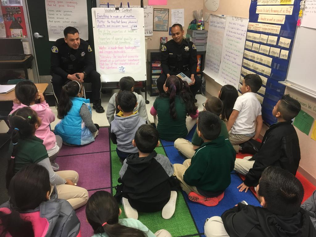 Police Officers reading to students