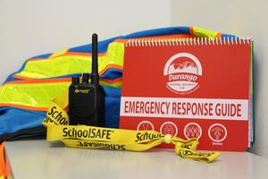 Image of standard response protocol assets, including a radio, ERG and jacket.