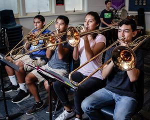Photo of band students playing their instruments.