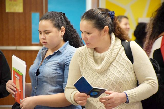 Parents collect resource materials during the EL Family Night