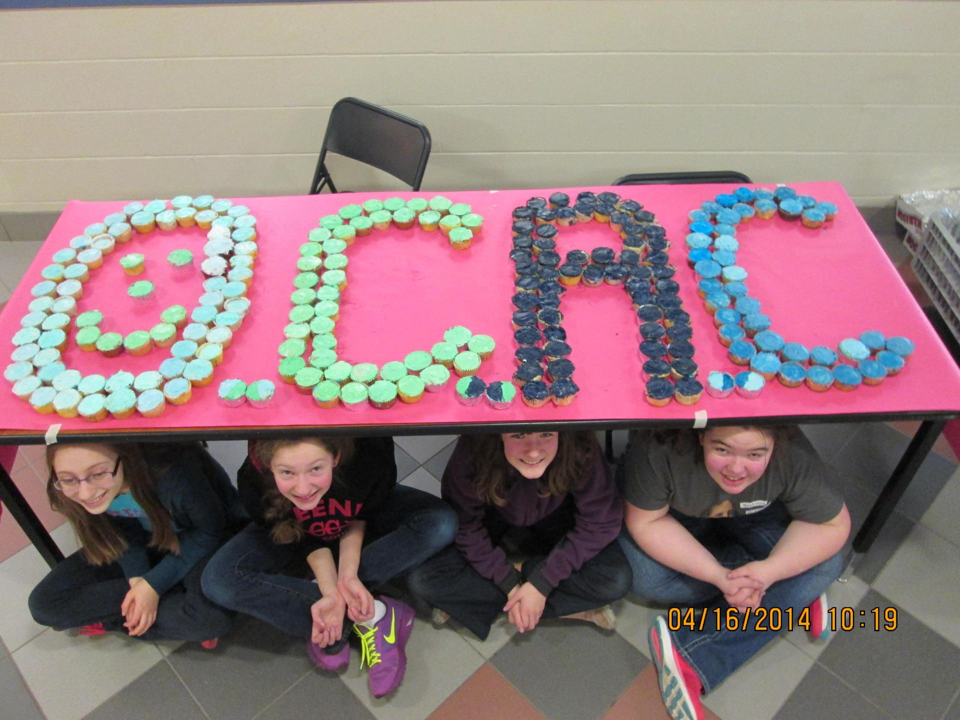 KMS Students with Colorful OCAC Display