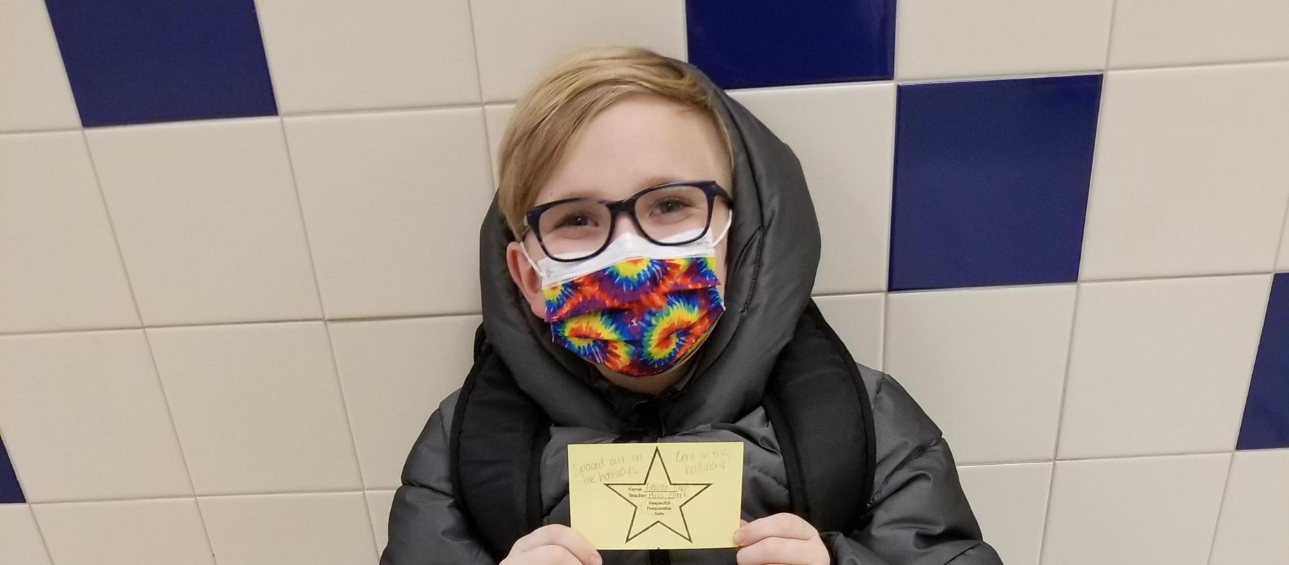 student wearing mask posing for the camera