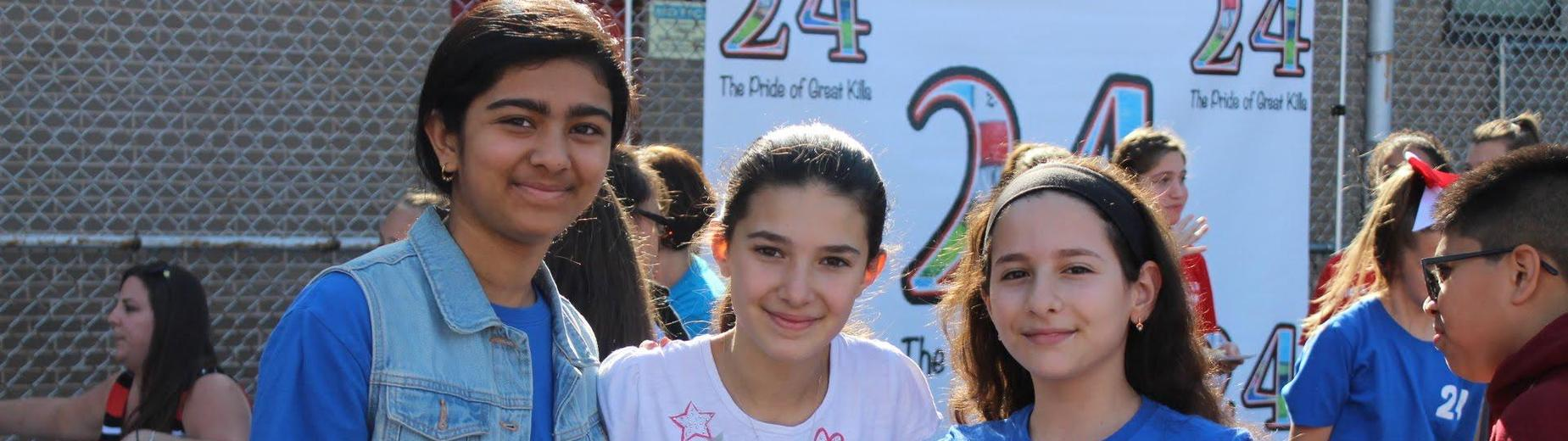 three seventh grade students at carnvial