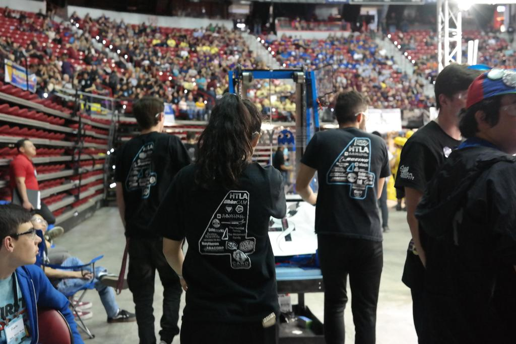 Drive team walking to field with robot