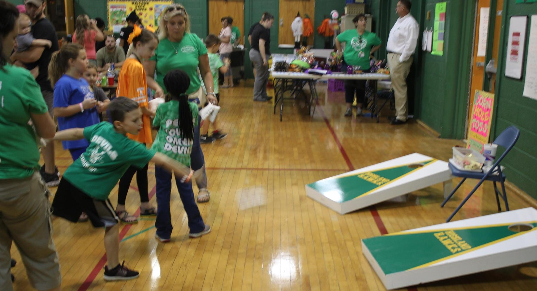 FunFestival for Education: Playing corn hole.