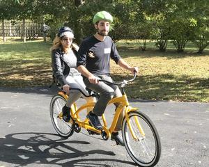 Student on a Tandem bike.