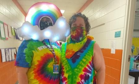 teachers dressed in rainbow