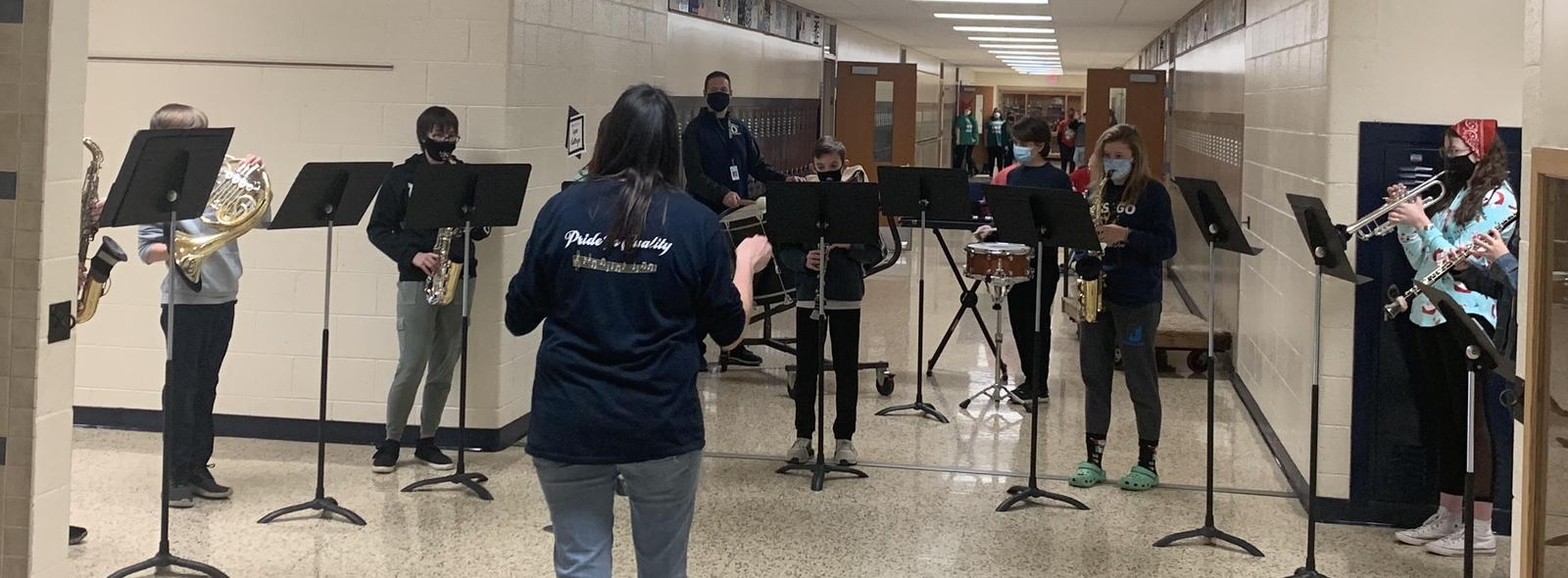 MS band performing in the hallway