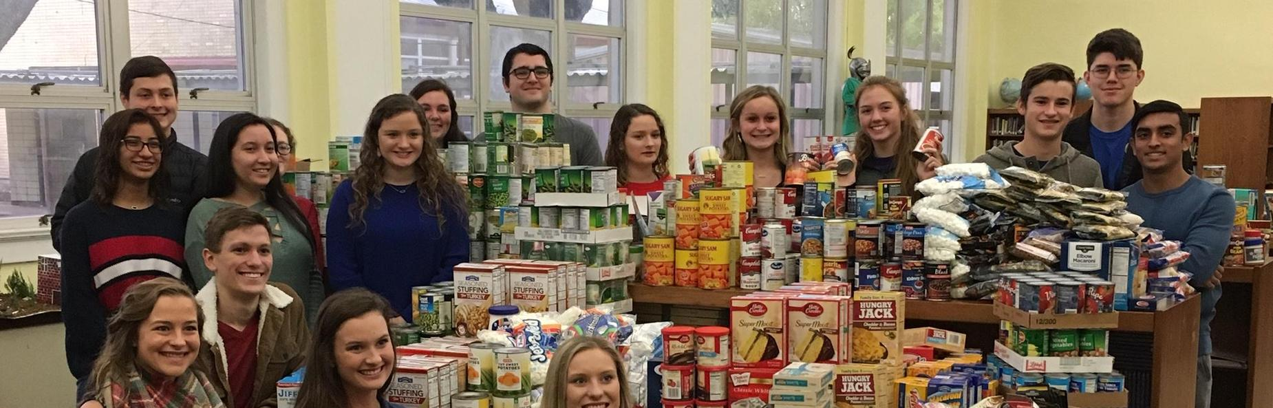students with food for food drive