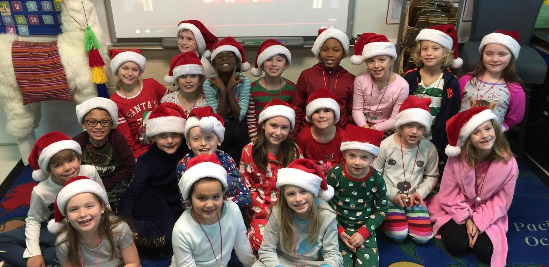 Students wearing pajamas and Santa hats