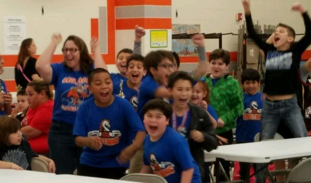 Chess team excited about tournament results.