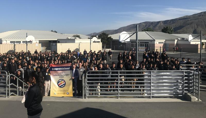SJLA Commadant Colonel Sick celebrates award of CA Distinguished Schools banner with cadets