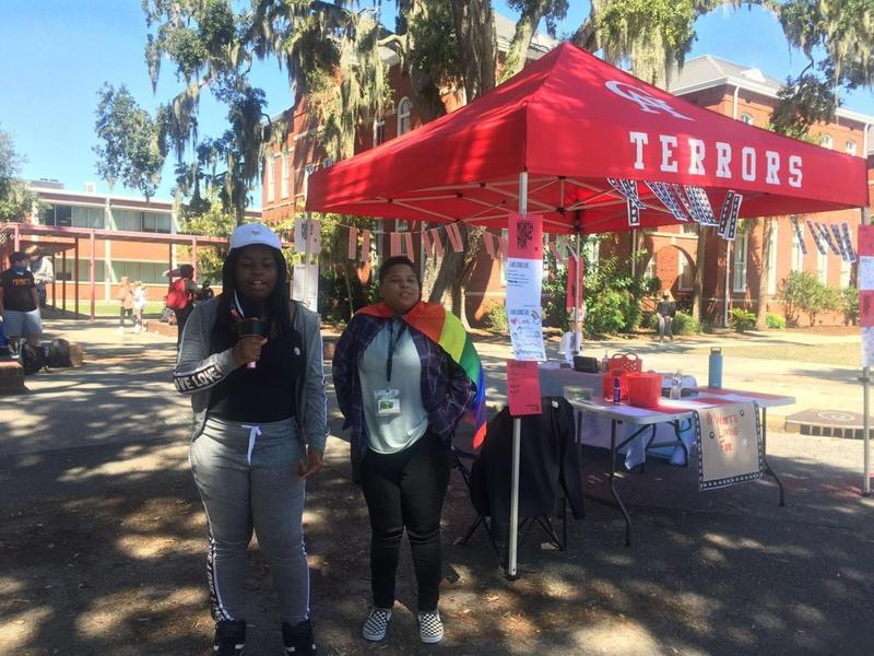 Glynn Academy freshmen Daija Chatman and Joshua Grey sing along to karaoke during the school's suicide prevention event Wednesday.