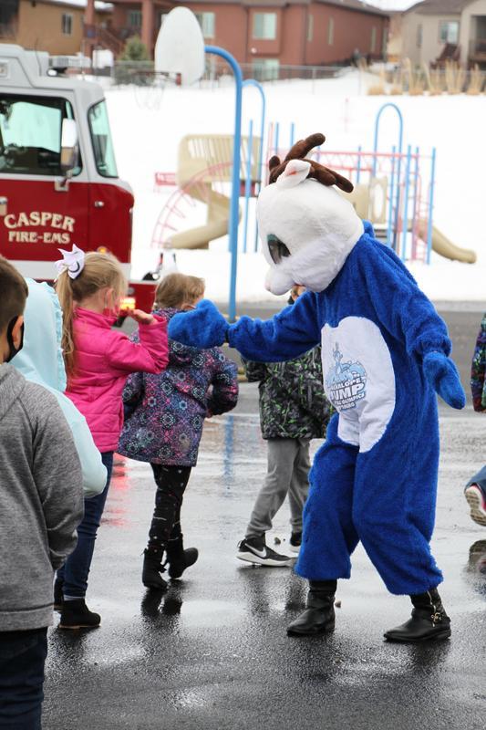 Jackalope Jump mascot greeting students
