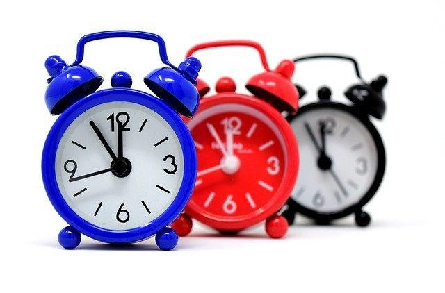 Three clocks; blue, red and black