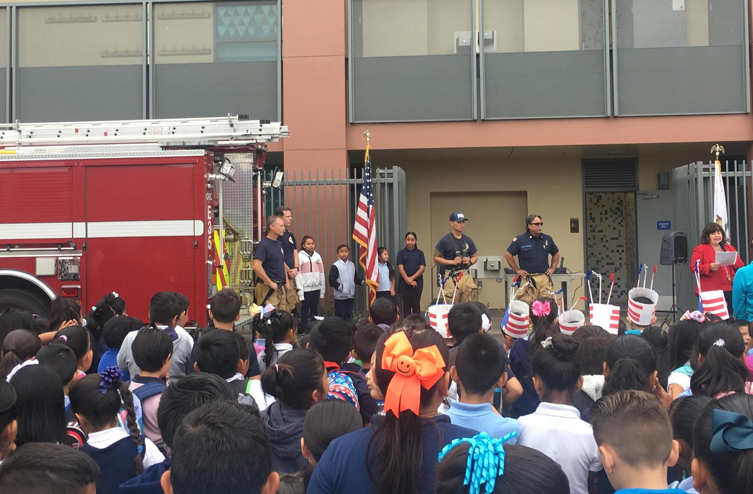 Students and Firemen Watching principal