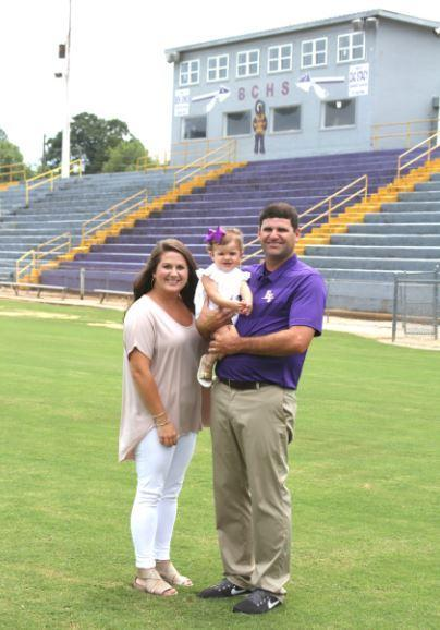 Offensive Coordinator and family, Kevin May, Nicki, and baby Monroe