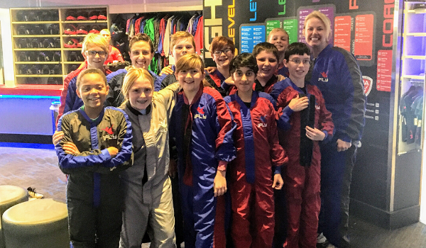 Students pose for a picture at the iFly field trip.