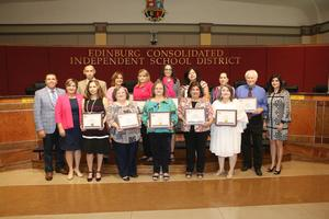 Members of the Edinburg CISD Human Resources Department display plaques in honor of Texas Education Human Resources Day.