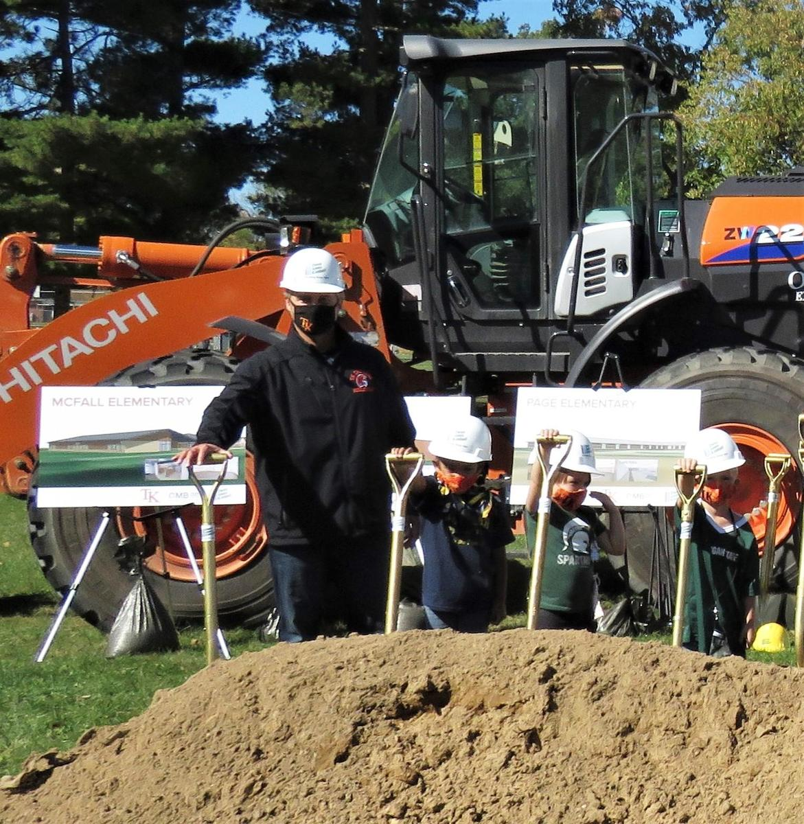 McFall Principal Jon Washburn and three McFall students take part in the groundbreaking ceremony.