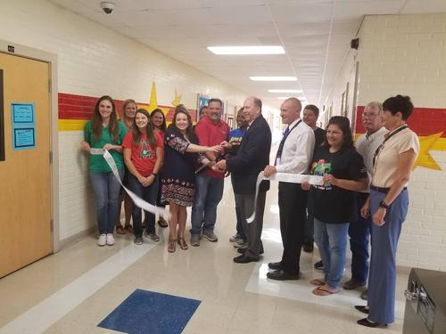 aloe elementary staff members, visd superintendent dr. shepherd, and visd board members participate in a ribbon cutting ceremony to celebrate the remodeling of aloe elementary from hurricane harvey damage
