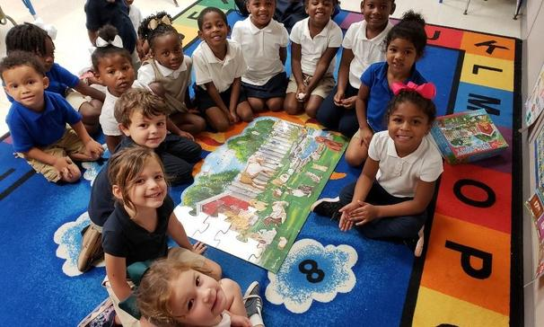 "Ms. Vidrine/Mrs. Jackson's Pre-K class at Palmetto Elementary participated in a friends and pets group lesson by constructing a ""Pet Party"" floor puzzle.  The children learned that just like the puzzle pieces, they are all an important part of the class especially when working together."