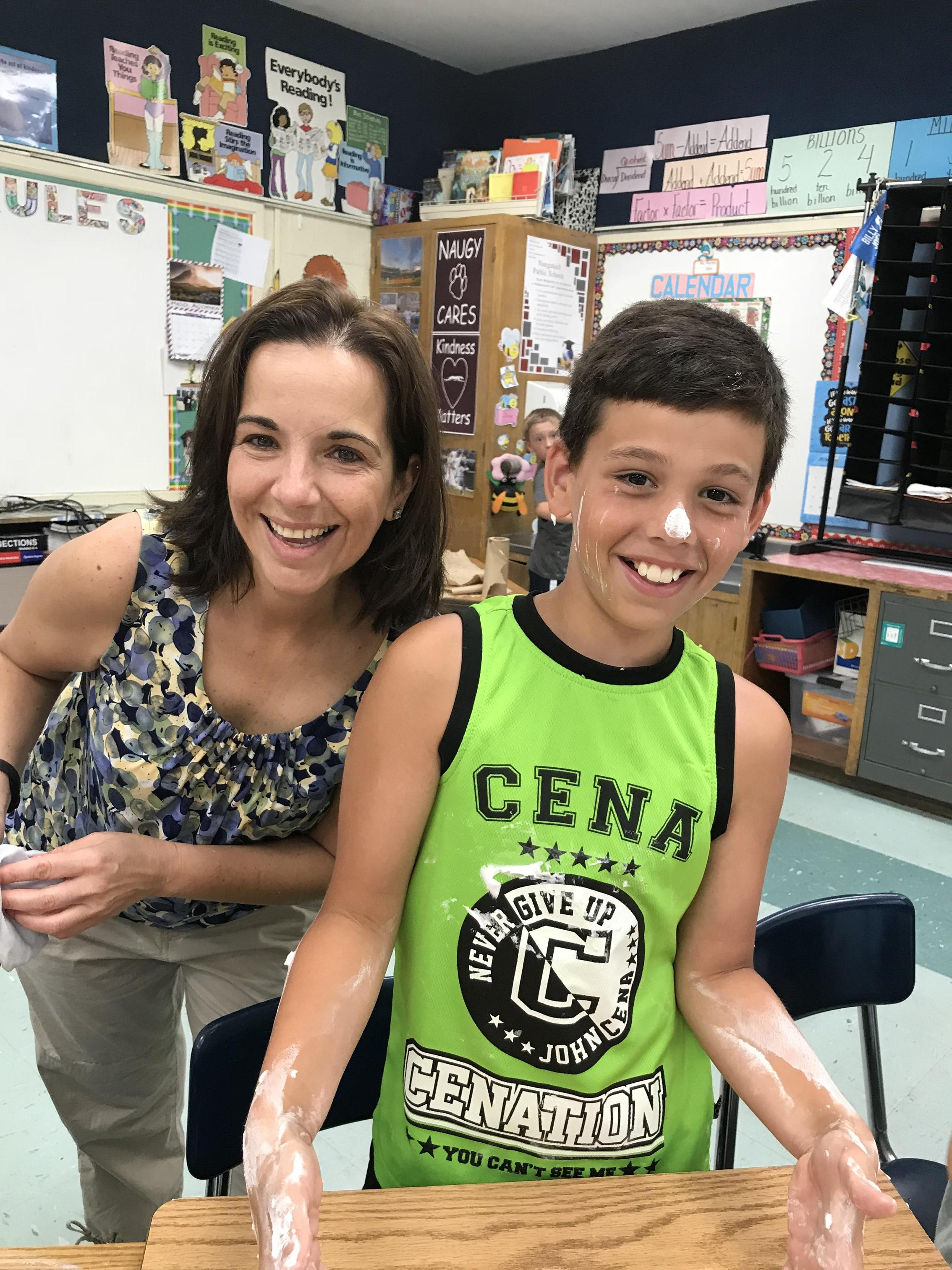 Mrs. Piscitelli with a student.