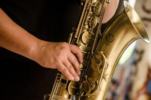 Photo of hands holding a saxaphone