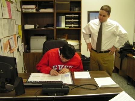 Dallas DeLaRosa signing his National Letter of Intent to play football at SVSU