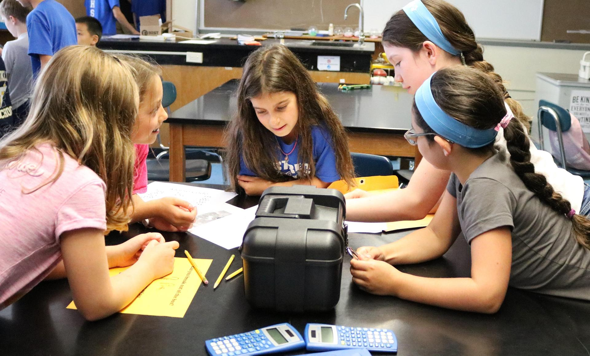 STEM campers use clues, encrypted codes, and ingenuity in a course modeled after the popular 'Escape Rooms.'