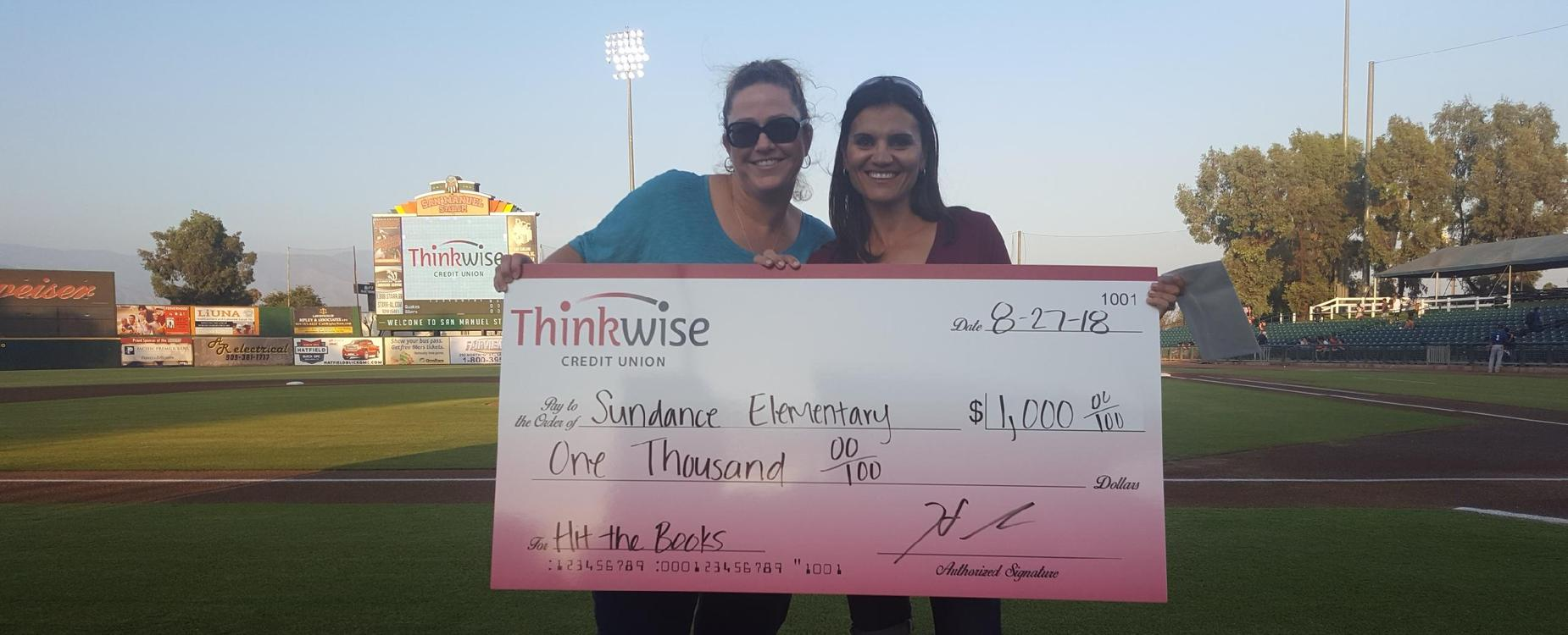 Principal & Clerk receiving our check for winning Hit the Books