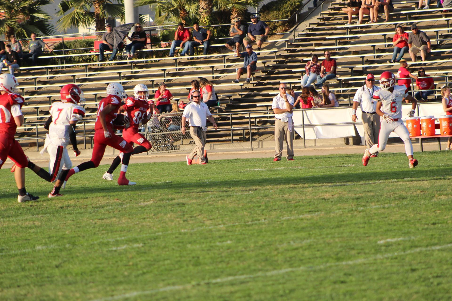 JV boys playing football against Kerman