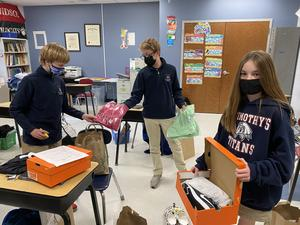 STS seventh graders organize items for the Salvation Army's Christmas Drive.