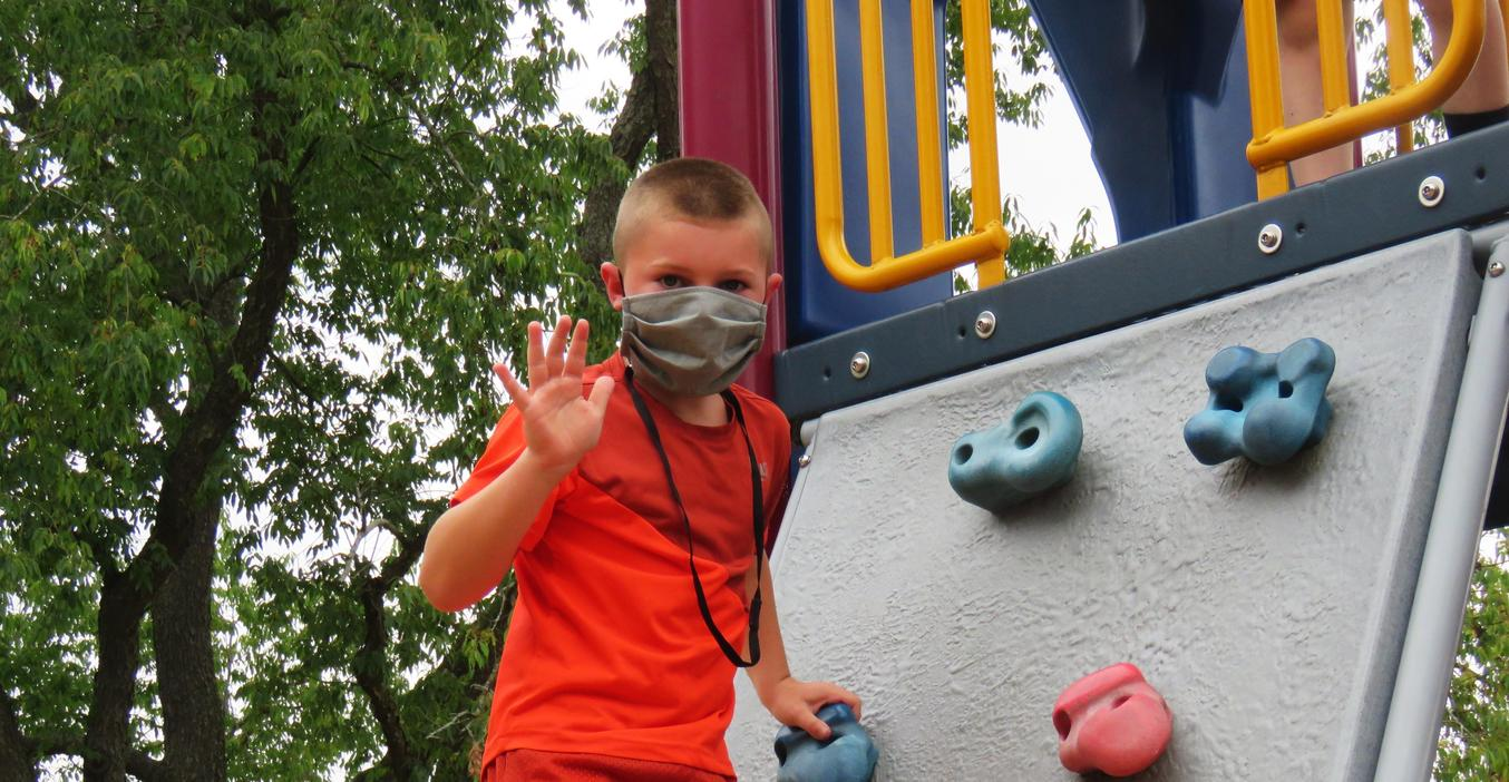 Although not required while on the playground, some students choose to wear their facial coverings.