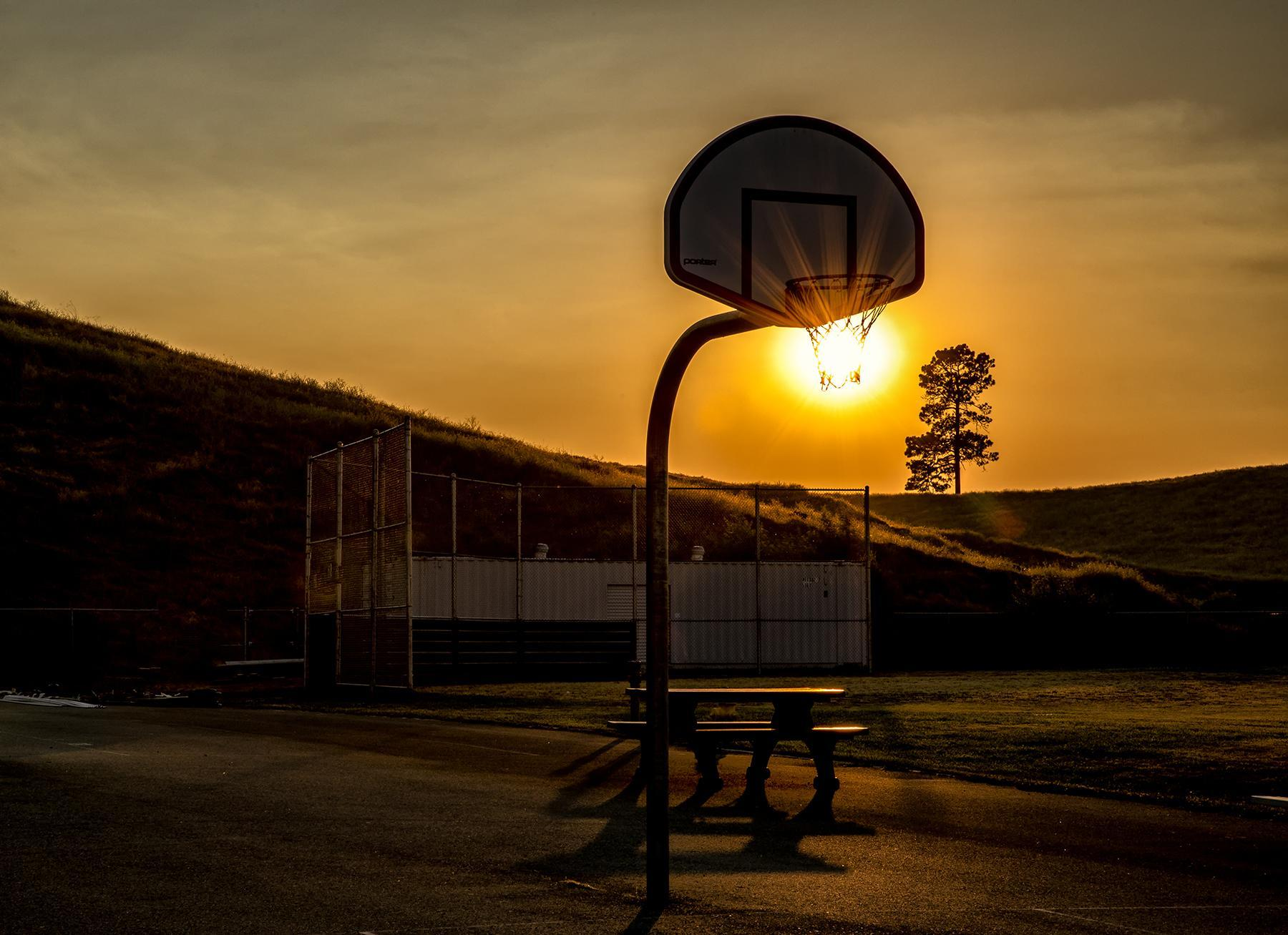 Sun Through Basketball Hoop