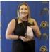 Nicole Calderilla holding her CIF Champion for Character award